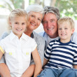 Happy family looking at camera — Stock Photo #10844570