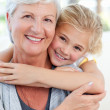 Lovely little girl with her grandmother looking at the camera — Stock Photo #10844585