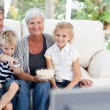 Stock Photo: Lovely family watching tv