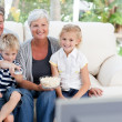 Foto Stock: Lovely family watching tv