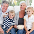 Foto de Stock  : Lovely family watching tv