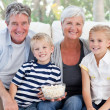 Lovely family watching tv — Stockfoto #10844589