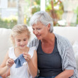 Senior knitting with her granddaughter — Stock Photo #10844622