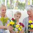 Radiant family with flowers — Stock Photo