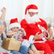 Stock Photo: SantClaus with happy family