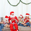 Santa Claus with a happy family - Stock Photo