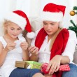 Stock Photo: Wonderful womon christmas day with her daughter