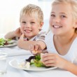 Happy children at the table — Stock Photo