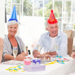 Seniors on birthday at home - Lizenzfreies Foto