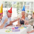 Seniors on birthday at home — Stock Photo #10844750