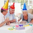 Seniors on birthday at home — Stock Photo