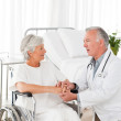 Doctor speaking with his patient — Stock Photo