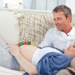 Lovely couple on their couch — Stock Photo #10844974