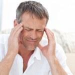 Man having a headache at home — Stock Photo