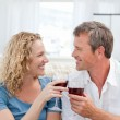 Royalty-Free Stock Photo: Couple drinking some red wine in the living room