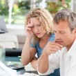 Desperate couple calculating their domestic bills — Stock Photo