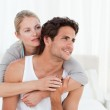 Lovely couple hugging on their bed — Stock Photo #10845156