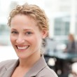 Smiling businesswoman in her office — Stock Photo #10845642