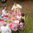 Family eating outside in the garden - Foto Stock