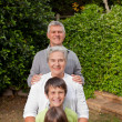 Grandparents with their grandchildren looking at camera — Stock Photo #10845809