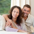 Couple sitting in their sofa — Stock Photo