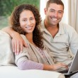 Couple working on their laptop at home — Stock Photo #10845911