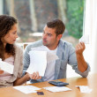 Young couple calculating their domestic bills — Stock Photo #10846201