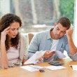 Young couple calculating their domestic bills — Stock Photo