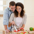 Handsome man cooking with his girlfriend — Stock Photo #10846218