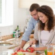Handsome man cooking with his girlfriend — Stock Photo #10846220