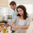 Stock Photo: Handsome man cooking with his girlfriend