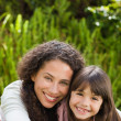 Adorable mother with her daughter in the garden — Stock Photo #10846368
