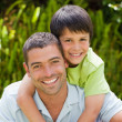 Father with his son hugging in the garden — Stock Photo #10846383