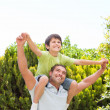Father with his son playing in the garden — Stock Photo #10846386