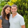 Happy couple hugging in the garden — Stock Photo #10846402