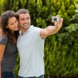 Couple taking a photo of themselves — Stock Photo