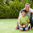 Happy father and his son playing baseball — Stock Photo #10846433