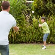 Happy father and his son playing baseball — Stock Photo