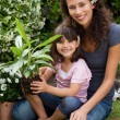 Mother and daughter working in the garden — Stock Photo