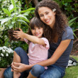 Stock Photo: Mother and daughter working in the garden