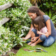 Mother and daughter working in the garden — Stock Photo #10846470