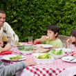 Royalty-Free Stock Photo: Happy family eating in the garden
