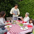 Man serving his family at the table — Stock Photo