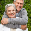 Mature couple hugging in the garden — Stock Photo #10846547