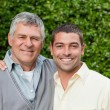 Father and his son looking at the camera in the garden — Stock Photo #10846591