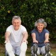 Retired couple doing their exercises — Stock Photo
