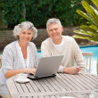 Retired couple working on their laptop — Stock Photo