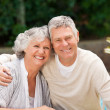 Senior couple hugging in the garden — Stock Photo #10846619