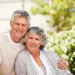 Stock Photo: Retired couple looking at camera