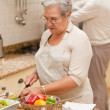 Senior couple cooking in the kitchen — Stock Photo